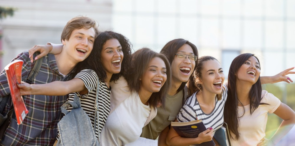 Canva - Multiethnic Group of Young Happy Students Standing Outdoors-1000x495.jpg